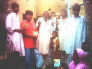 Group Photo of Holy Bible CD's in a unreached area